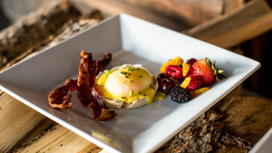 Eggs benedict with bacon.