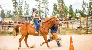 Little girl horse back riding