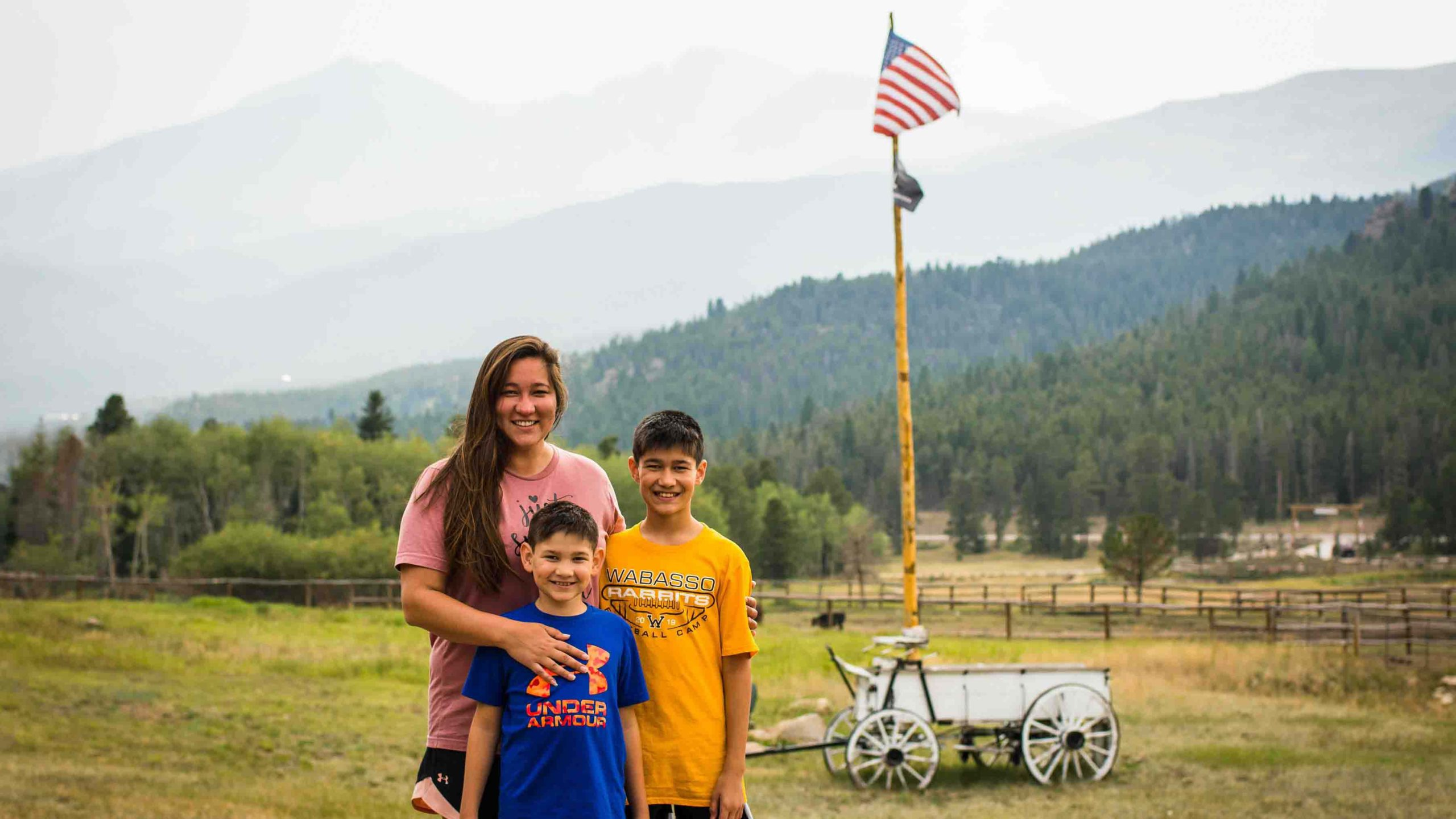 Family posing in front of the american flag
