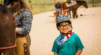 Camper excited to get on a horse