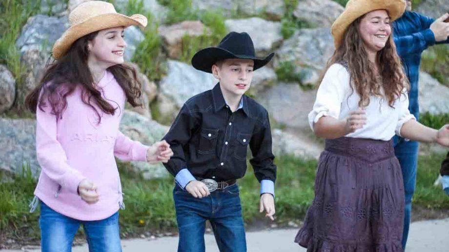 Children in cowboy hats
