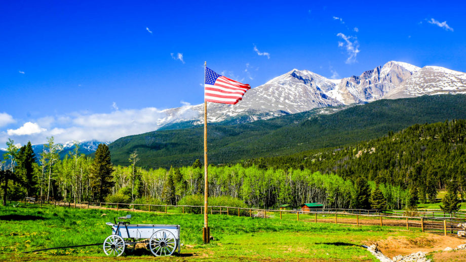 American flag and beautiful mountain landscape.