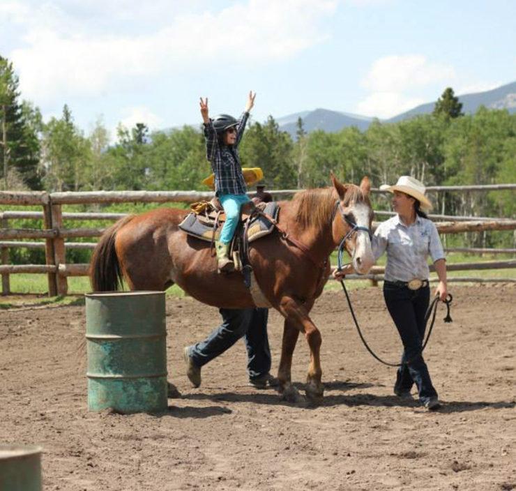 A child riding a horse.