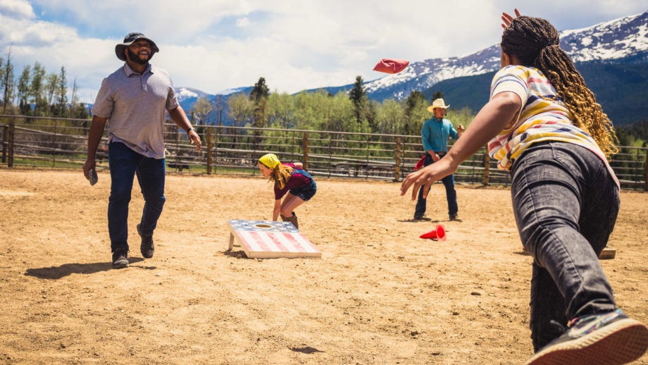 A family playing corn hole together.