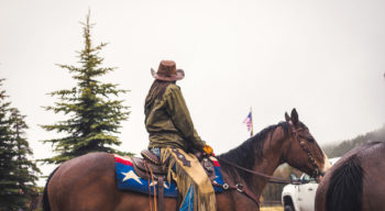 A woman riding a horse.