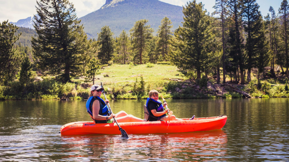 Two young women kayaking together.