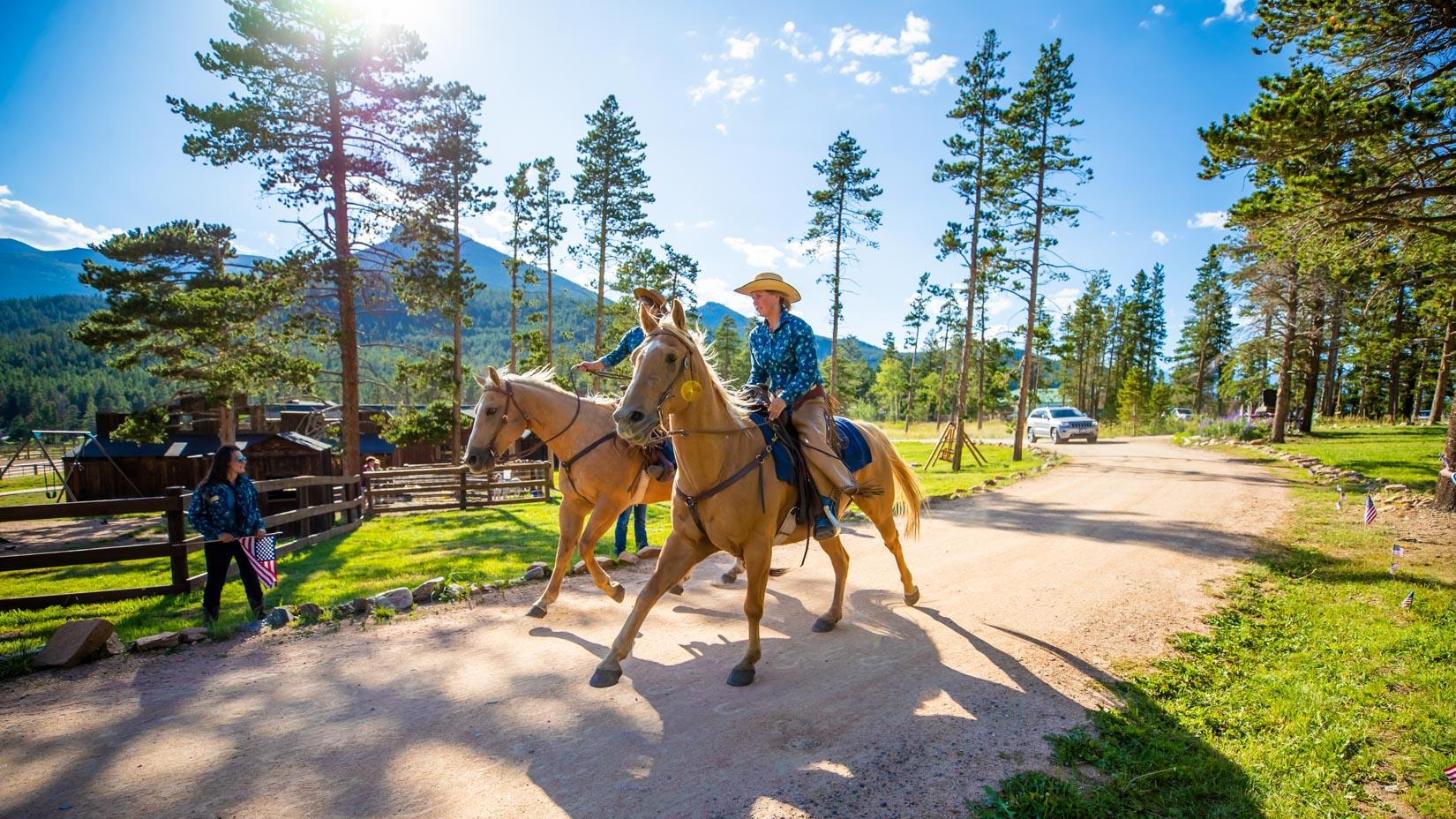 Horseback riders.
