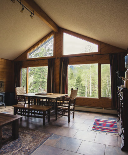 Chalet cabin large window facing a fantastic mountain view.