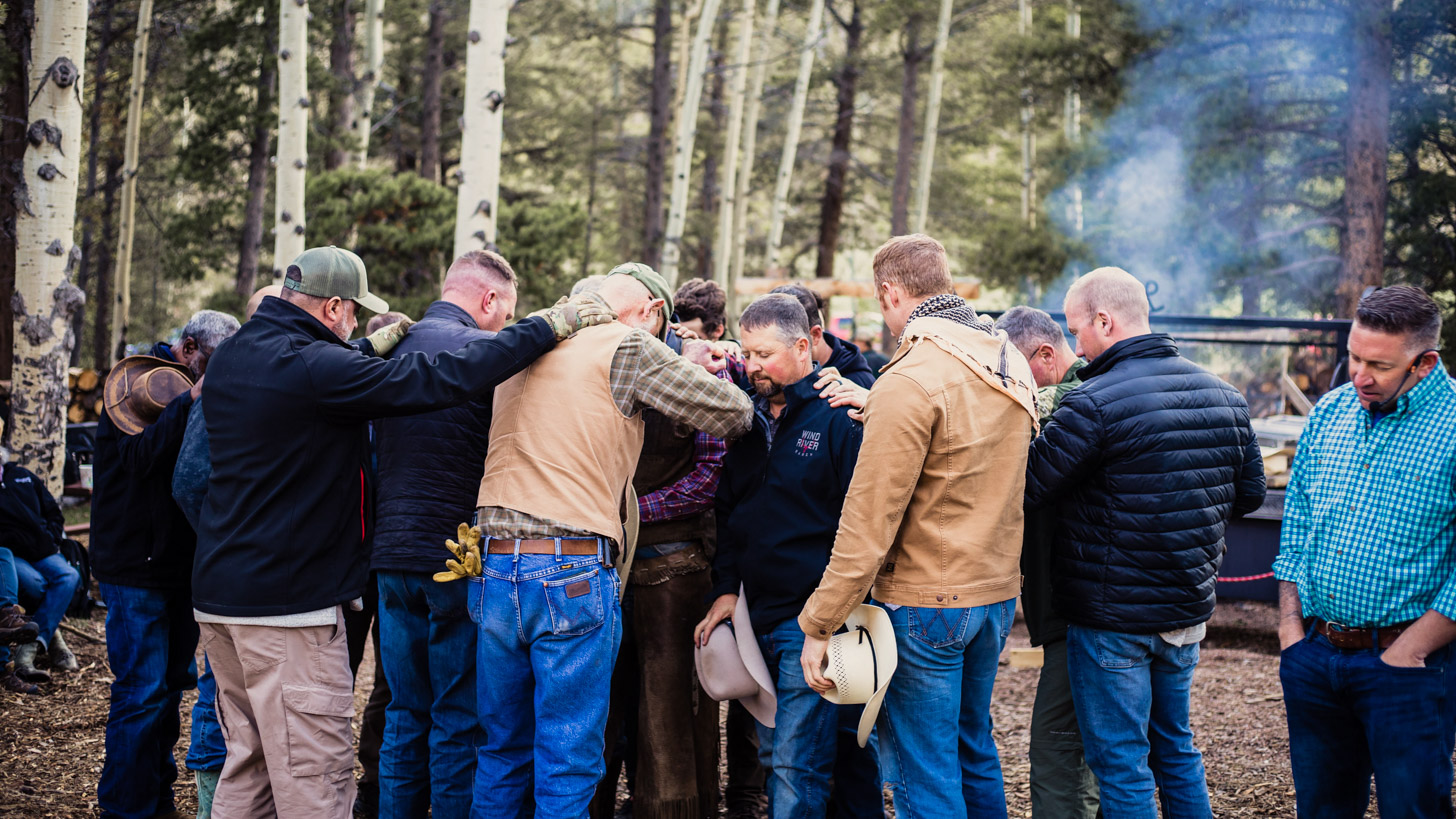 Group of men hugging and being emotional