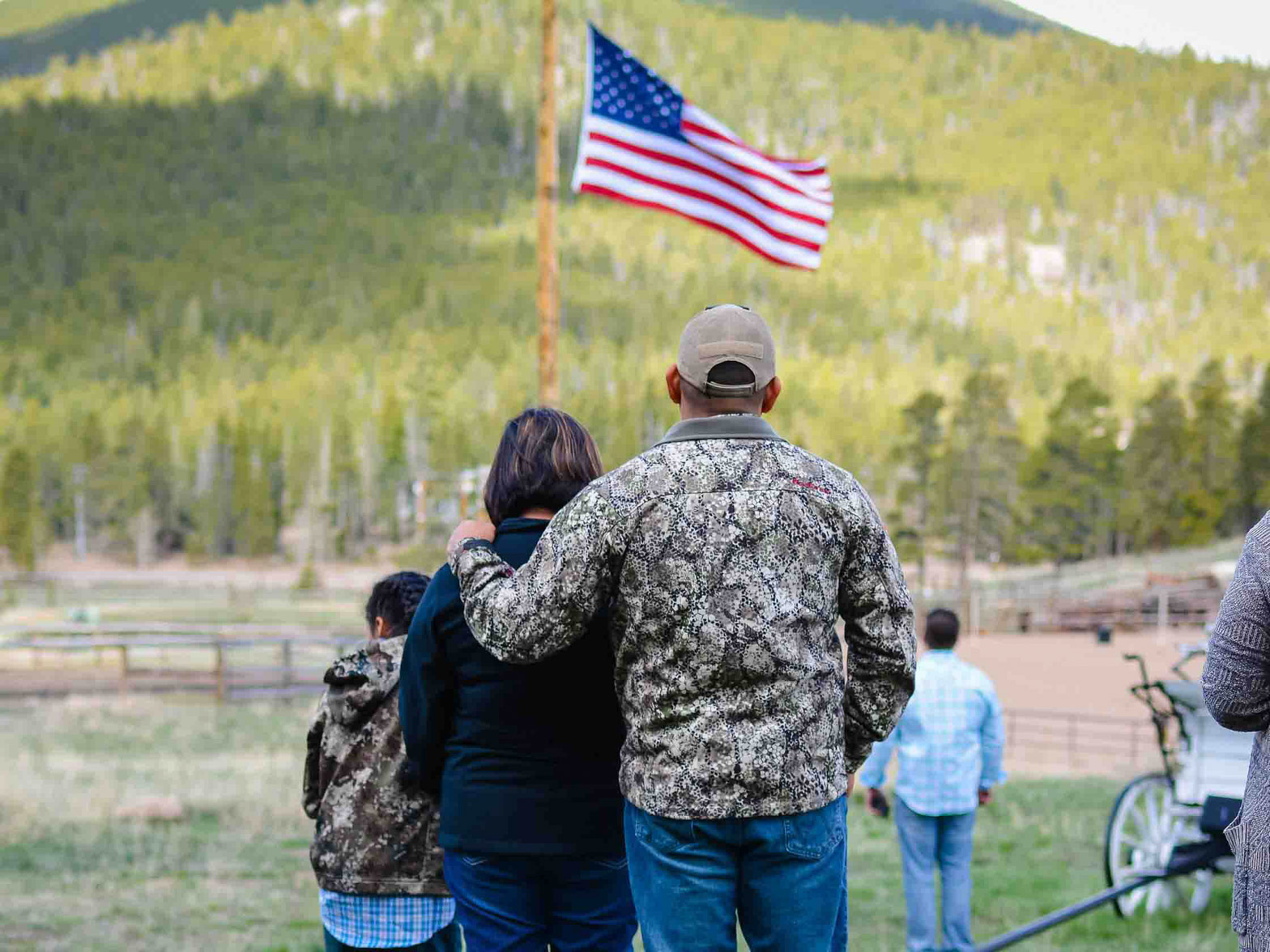 Family starring at the American flag.