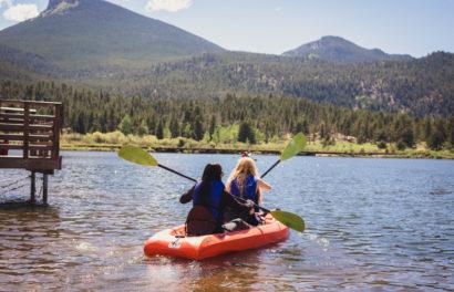 Two girl kayaking in a lake.