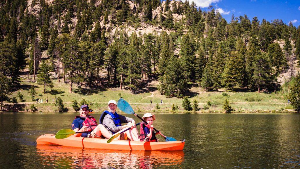 Family kayaking in a lake .