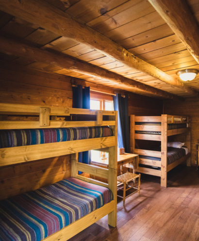 Two sets of Bunk beds in a cabin.